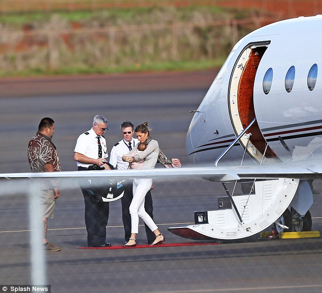 Jetting in: She jetted in to the island on a private plane, seen here stepping down onto a little red carpet