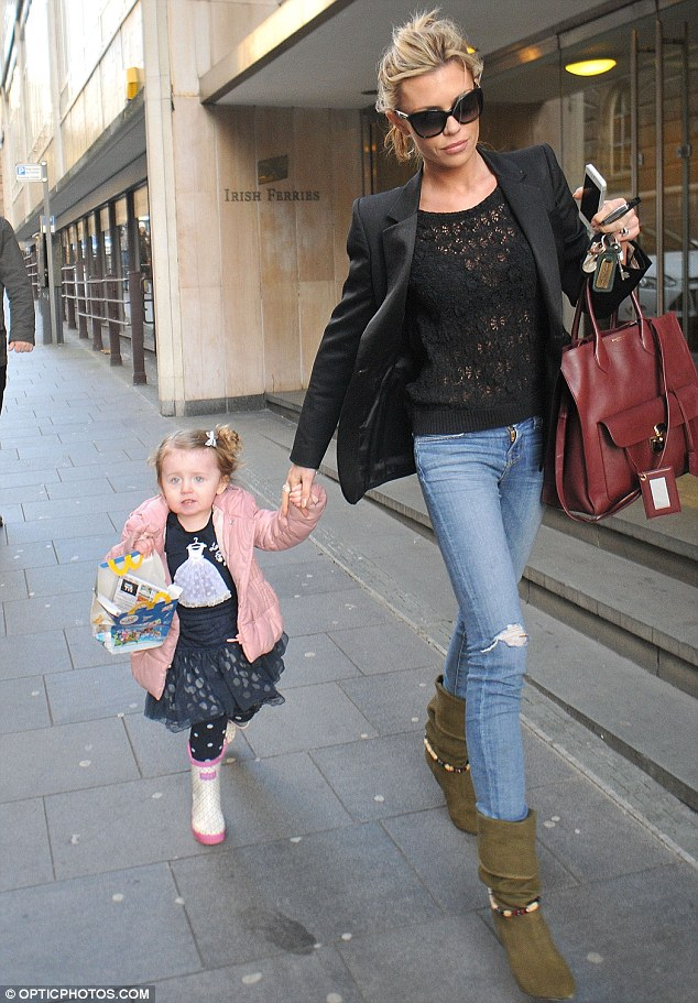 McHappy days: Abbey Crouch and her daughter Sophia leaving a McDonald's in Liverpool city centre on Friday
