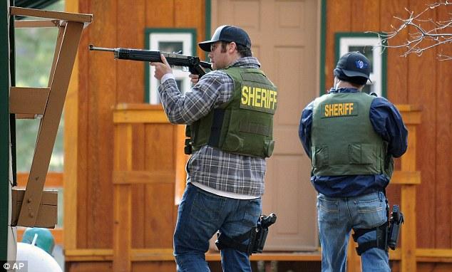 Hunting: San Bernardino County sheriff's deputies armed with Ruger Mini14 assault rifles went door-to-door hunting for Dormer