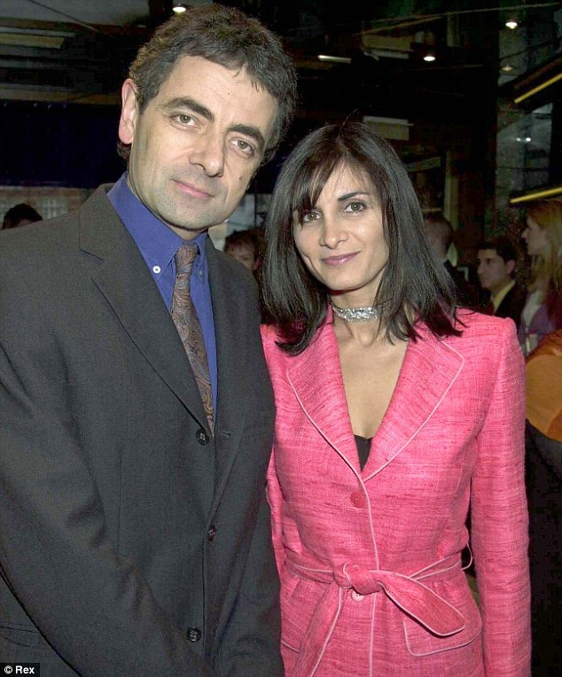 Expensive: Atkinson, seen with his wife Sunetra, paid £634,500 for the maroon sports car in 1997, but has seen its value soar in recent years