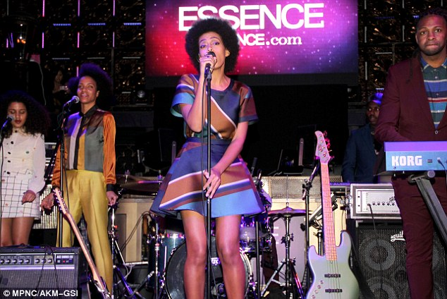 Stunning turn: She looked fantastic in her patterned, structured dress as she entertained the crowd