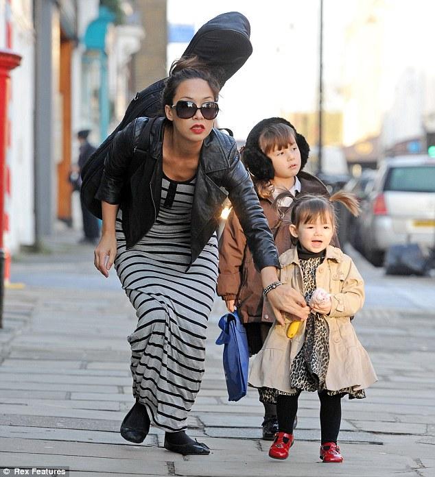 Mummy duties: Myleene seemed to be taking Ava to school as the little girl was in her school uniform