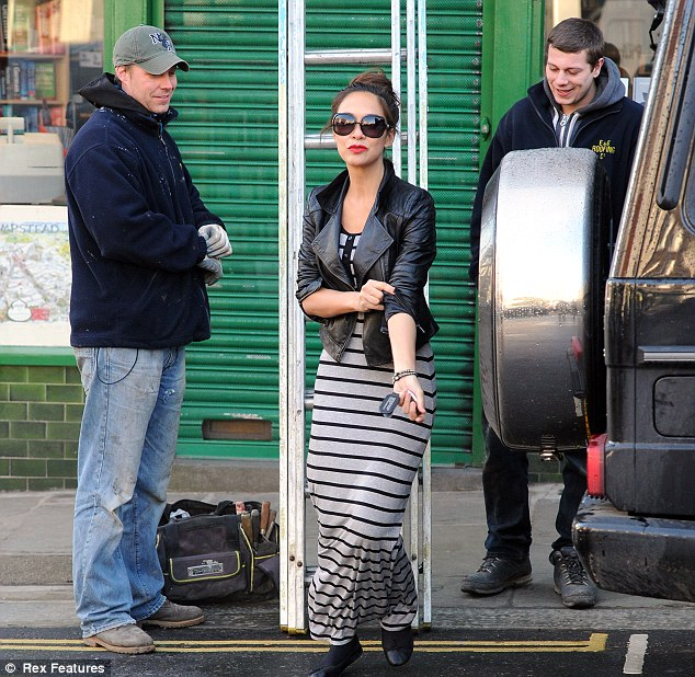Can't take my eyes off of you: Myleene seemed to be finding something funny as the men looked on