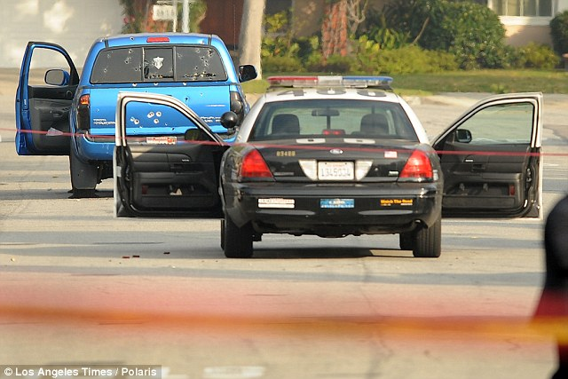 Mistake: Police shot at this truck after believing Dorner was inside. Two people were wounded but were expected to survive