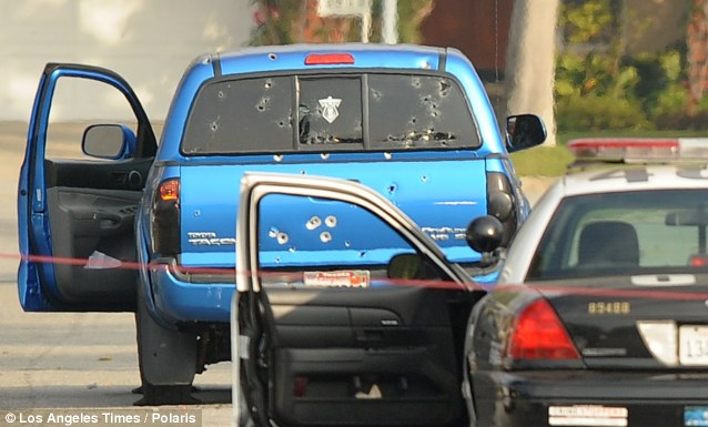 Damage: A close-up look at the many bullet holes in the pickup truck driven by a woman and her 71-year-old mother delivering newspapers