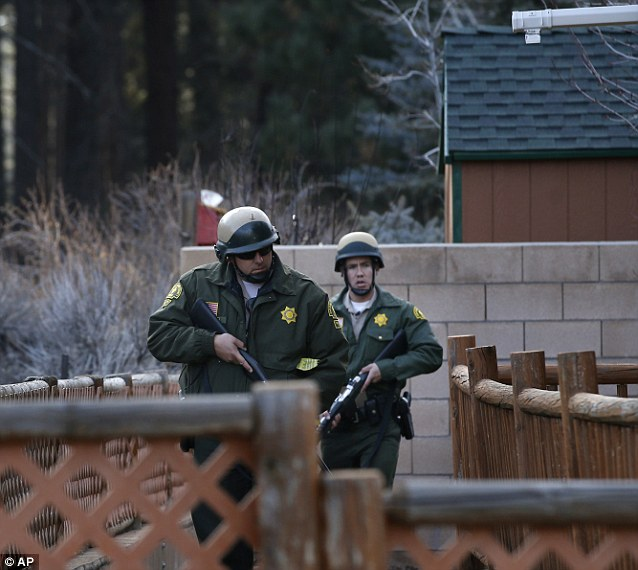 Hunting: The officers continued to search for Dorner into the night - even though a massive snowstorm was scheduled for the mountain community