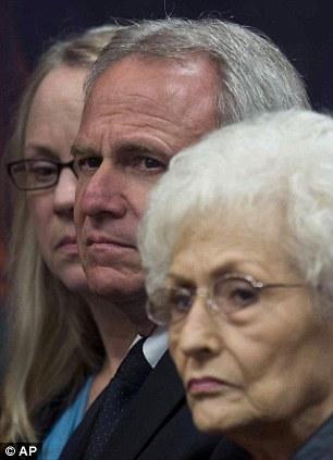 Michael Morton sits next to his mother Patricia Morton