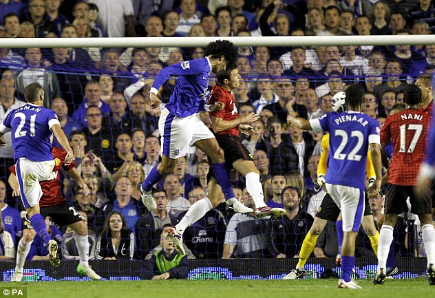 Tall order: Marouane Fellaini nods the only goal of the game at Goodison as Everton inflicted defeat on Manchester United in August