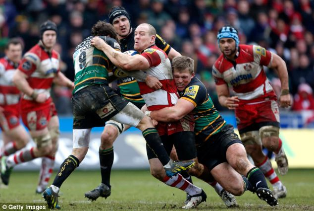 Into contact: Mike Tindall (centre) is brought down