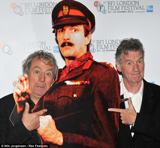 Friends till the end: Terry Jones, left and Michael Palin, right, stand next to a cardboard cut-out of Graham Chapman at a preview of A Liar's Autobiography