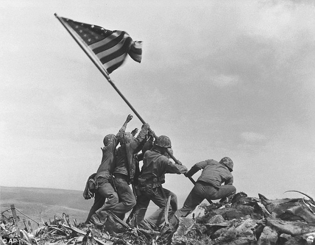Original photo: This February 23, 1945 file photo shows U.S. Marines of the 28th Regiment, 5th Division, raising the American flag atop Mt. Suribachi in Iwo Jima, Japan