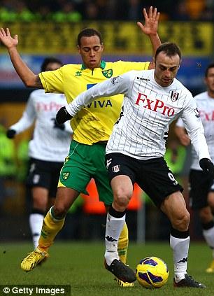 Hold up: Berbatov thwarts Norwich's Elliott Bennett
