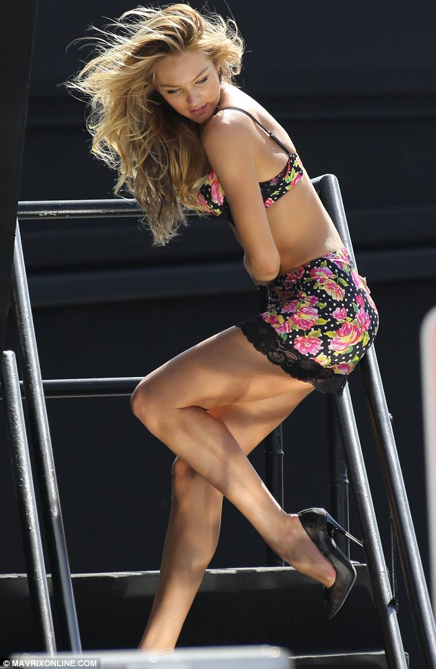 Weather girl: Candice used the wind machine on set to full advantage as she smouldered on a flight of stairs