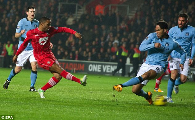 Number one: Puncheon opens the scoring against Manchester City