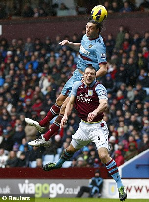 Nullified: West Ham's Andy Carroll (top) struggled to make an impact on the first half