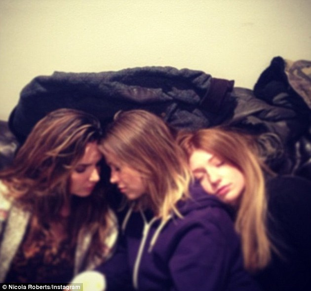 Sleeping beauties: Nicola Roberts posts a picture of herself having a nap with Girl Aloud band mates Nadine Coyle and Kimberley Walsh during tour rehearsals
