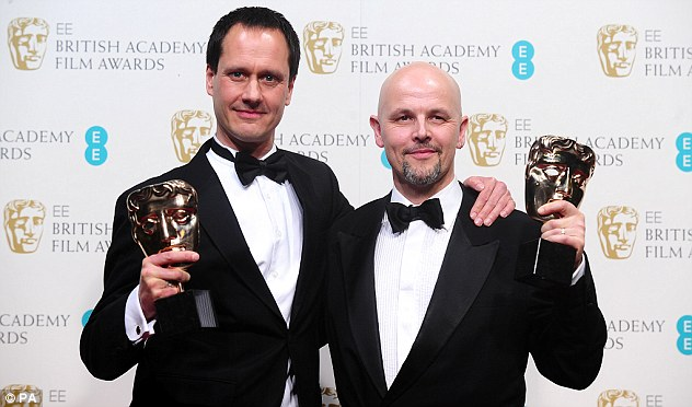 Making a splash: Diarmid Scrimshaw (left) and Peter Carlton with the Award for Best Short Film for Swimmer