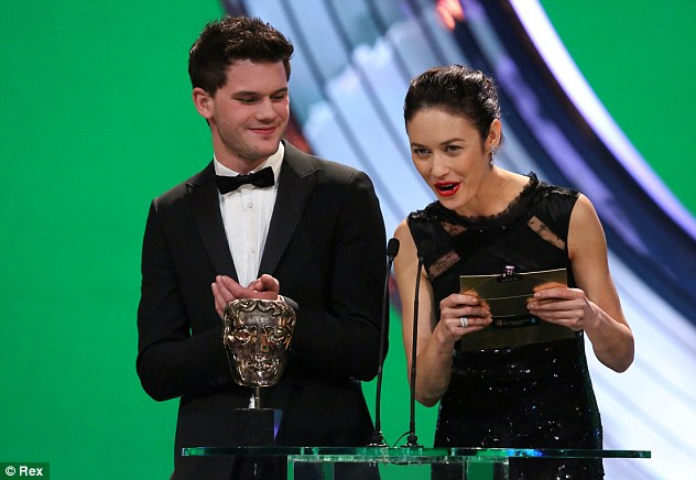 Presenting pair: Jeremy Irvine and Olga Kurylenko take to the stage to present the BAFTA for Best Sound and Editing to Les Miserables and Argo respectively