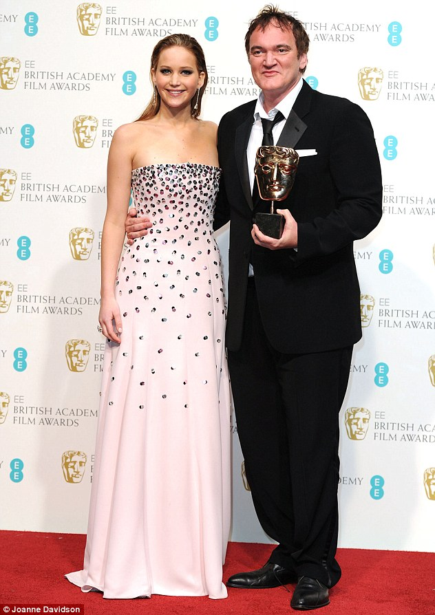 Making new friends: Jennifer posed up with Django Unchained's Quentin Tarantino after presenting him with his prize