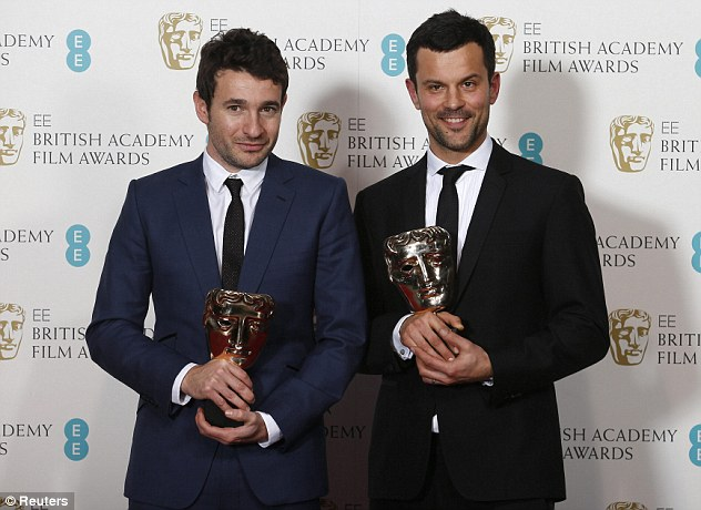 Dapper dudes: Bart Layton (left) and Dimitri Doganis celebrate after winning the Outstanding Debut by a British Writer, Director or Producer for The Imposter