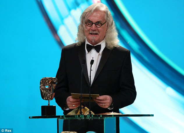 Funnyman: Joking that he was 'presenting an unsuspecting stranger with a deathmask on a stick', the comedian and actor gave the award to Layton and Doganis