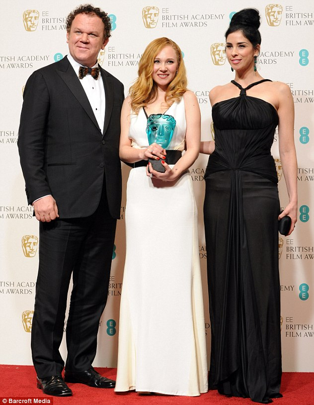 Famous trio: Juno was presented her award by John C Reilly and Sarah Silverman