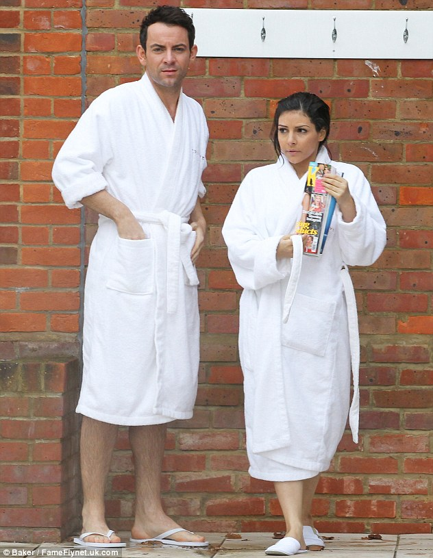 All white now: The pair wrapped up in their Champneys dressing gowns and slipper following their jacuzzi session