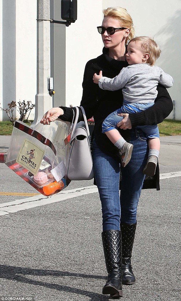 Sweet tooth: January Jones takes her 17-month-old son Xander with her as she buys some cupcakes from Crumbs Bake Shop on Sunday in Los Angeles