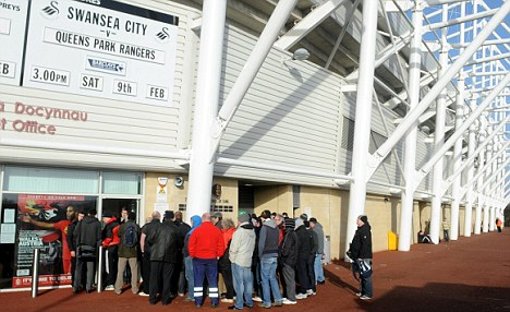 See you at Wembley: Swansea supporters queue for final tickets