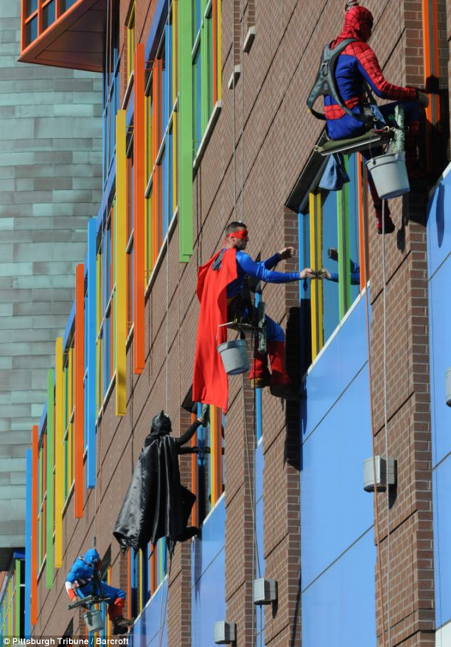 Is it a bird? It is a plane? No it's window washers who dressed up as superheroes to entertain patients at the Children's Hospital of Pittsburgh in Pennsylvania