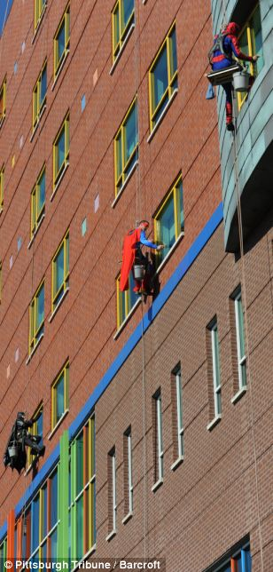 The group said they were touched by the excited reaction of the children when they saw the superheroes outside the hospital window
