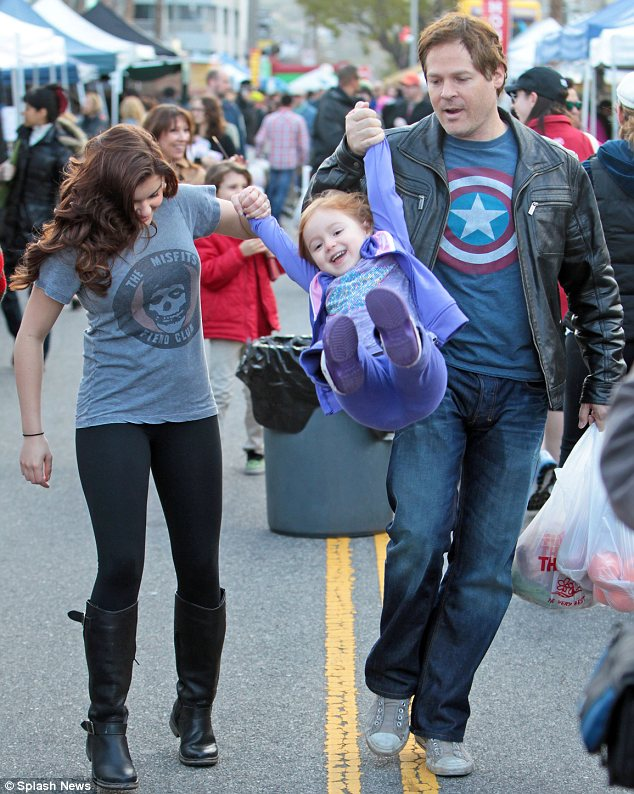 Number one auntie! Ariel Winter dotes on her niece Skylar at a Farmer's Market with her brother-in-law David Barry Gray