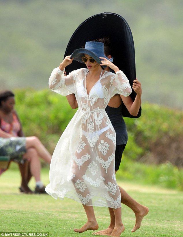 Miranda Kerr shows off her underwear in revealing lace dress for beauty shoot on a Sydney Beach