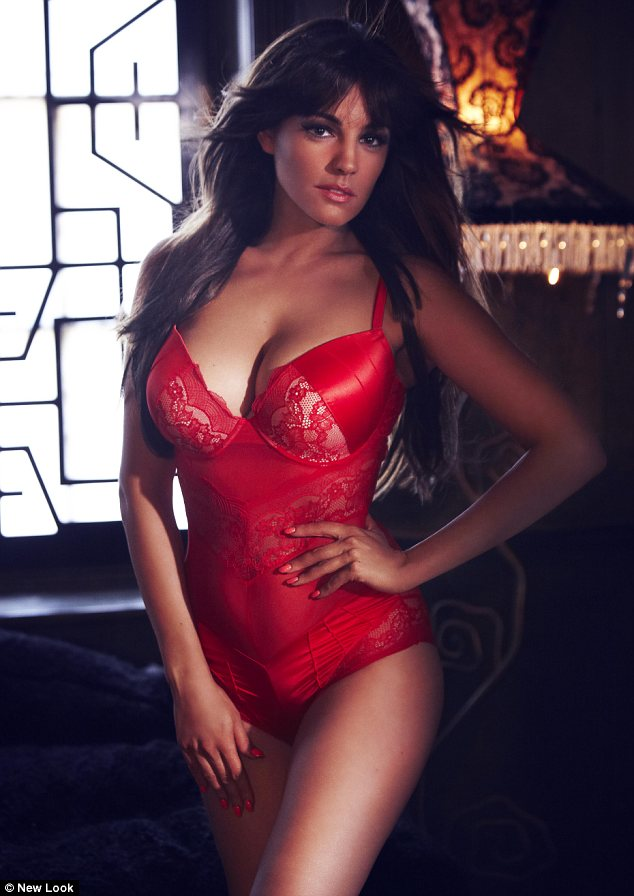 She's smoking: The Kent-born beauty showed off her shape in this bright red basque