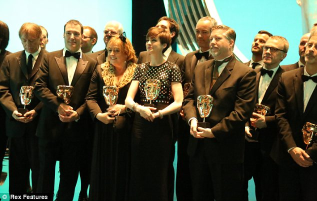 All together now! The winners gather with their golden masks