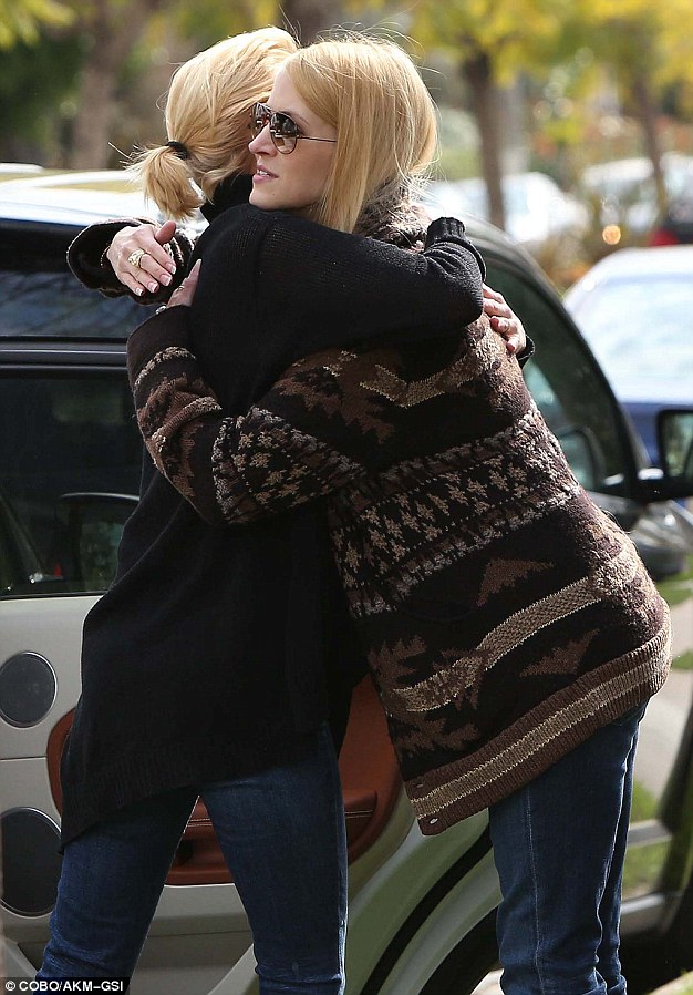 Lean on me: The two moms embraced when they said goodbye, no doubt supporting each other in the early stages of motherhood