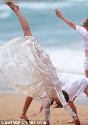 Cartwheel: Miranda proves your never too old for some beach acrobatics