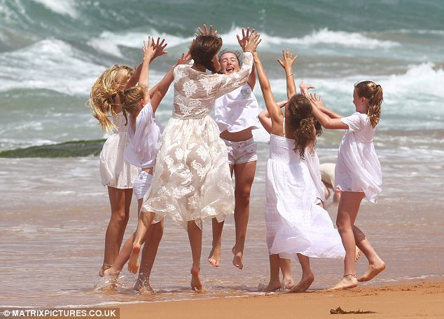 Woop! Miranda and her ladies in white jump up in excitement, to give each other high fives