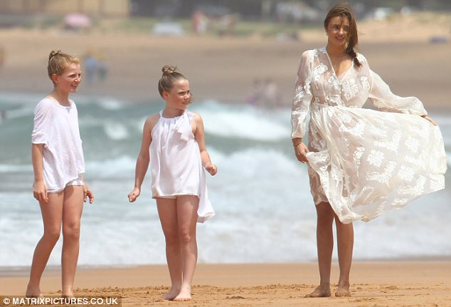 Billowing: Miranda's cream lace dress blew up in the wind