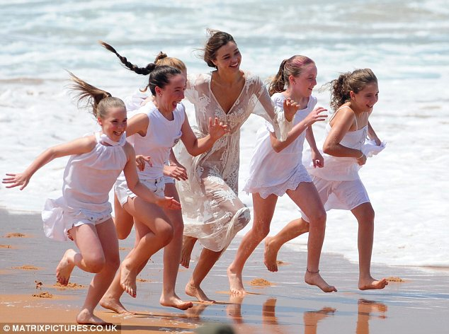 Ready, steady, Go! Miranda races the girls up and down the beach