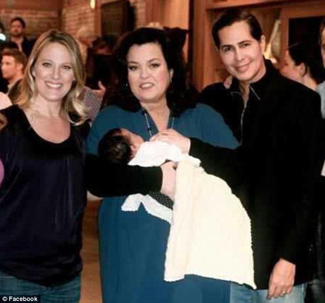 Modern families: Dawn Pieke (left), on Rosie O'Donnell's show with co-parenting partner Fabien Blue (right) and their child, Indigo