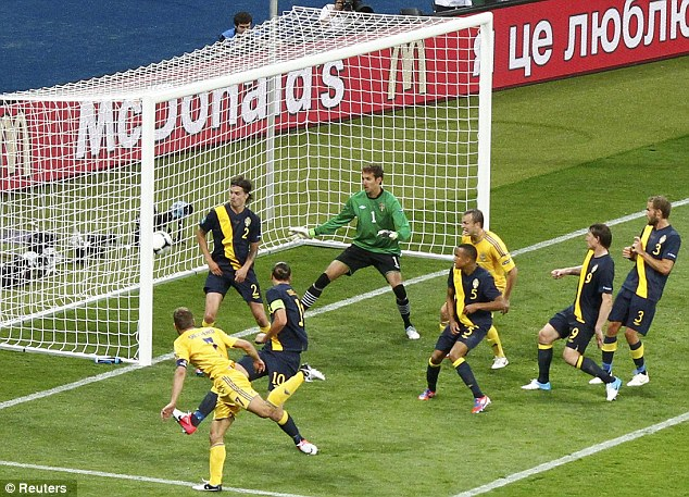 National hero: Shevchenko scores against Sweden in one of his final games for the co-hosts of Euro 2012