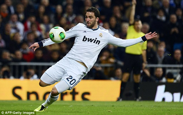 Confident: Gonzalo Higuain thinks Real Madrid can do a lot of damage to Manchester United