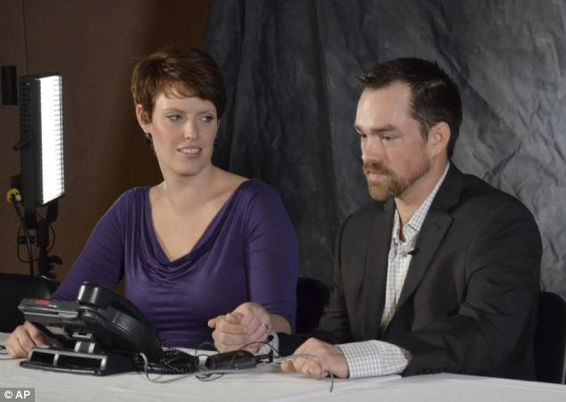 Support: He is pictured last month with his wife, Tammy, during a press conference in Minot, N.D. after it was announced he would receive the Medal of Honor for his action during the 13-hour firefight