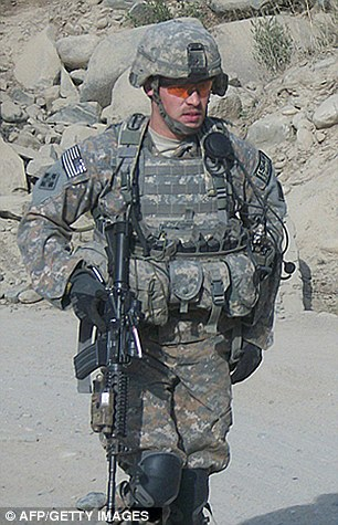 Hero: Former Army Staff Sgt. Romesha is pictured on a mission in Afghanistan in 2009
