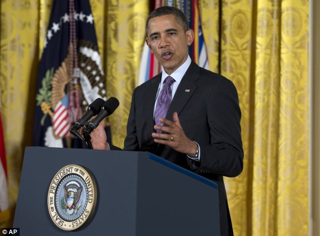Tribute: Before he presented the away, Obama said the attack reminded him that troops should never be 'put in a position where they have to defend the indefensible'