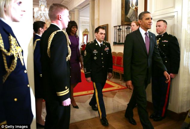 'Humble guy': Romesha enters the East Room with President Obama and First Lady Michelle Obama