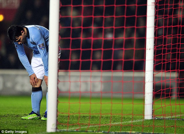 Title gone begging: Sergio Aguero reacts to another missed Man City opportunity during Saturday's 3-1 defeat at Southampton