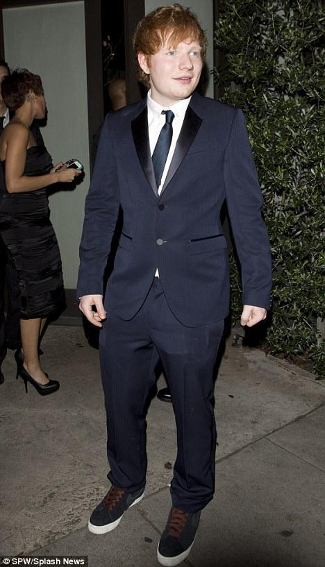 Dapper: Ed Sheeran looks smart as he has a cigarette break outside Osteria Mozza in Los Angeles on Monday night