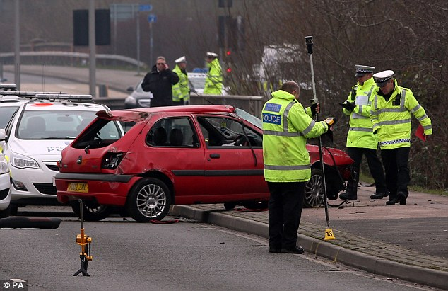 Investigation: The road in Reading, Berkshire, remained closed for more than 12 hours while officers looked into the crash